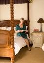 Older lady reading magazine Royalty Free Stock Photo