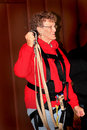 Older lady ready for zipline an senior citizen getting and wearing zip line gear shallow depth of field Stock Images