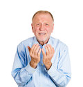 Older man begging closeup portrait of desperate senior mature showing hands in air pretty please with sugar on top isolated on Royalty Free Stock Photography