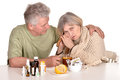 Older man caring for sick woman caucasian men elderly Stock Photo