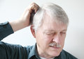 Older man with dry scalp Royalty Free Stock Photos