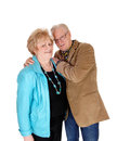 Older man hugging his wife a lovely couple embracing each other the men standing beside holding her isolated for white background Royalty Free Stock Photos