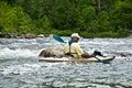 Older Man Kayaking/River Rapids Stock Photography