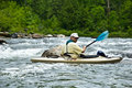 Older Man Kayaking/River Rapids Royalty Free Stock Image