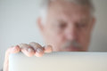 Older man looks at laptop with copy space Royalty Free Stock Photo
