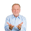 Older man offering you something closeup portrait of senior mature smiling happy excited with raised up palms arms at isolated Stock Image