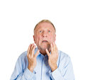 Older man pleading begging up above closeup portrait of mature praying imploring hands in air hoping for best asking forgiveness Stock Images