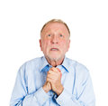 Older man pleading begging up above closeup portrait of mature praying imploring hands clasped hoping for best asking forgiveness Royalty Free Stock Images