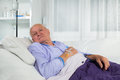Older man receives infusion Royalty Free Stock Photo