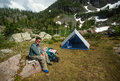 Older Man Resting in Backpacking Camp Royalty Free Stock Photo