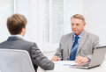 Older man and young man having meeting in office business technology concept men men Royalty Free Stock Photos