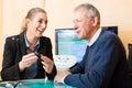 Older men pensioner hearing problem make hearing test may need hearing aid Royalty Free Stock Photo