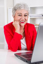 Older office worker with laptop portrait of Royalty Free Stock Photography