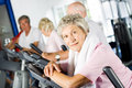 Older people exercising in the gym Stock Image