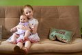 Older sister holds little younger a Royalty Free Stock Image