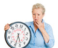 Older woman aging running out of time closeup portrait old business funny looking elderly lady holding clock stressed pressured by Royalty Free Stock Photos