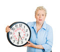 Older woman aging running out of time closeup portrait old business funny looking elderly lady holding clock stressed pressured by Royalty Free Stock Image