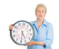 Older woman aging running out of time closeup portrait old business funny looking elderly lady holding clock stressed pressured by Royalty Free Stock Photography