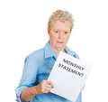 Older woman angered by her monthly statement closeup portrait of sad shocked funny looking senior old disgusted at isolated white Royalty Free Stock Images
