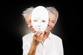 Older woman hiding happy and sad face behind mask Royalty Free Stock Photo
