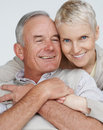 Older woman hugging her husband from behind Royalty Free Stock Photo