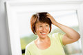 Older woman looking into the mirror Royalty Free Stock Photo