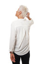 Older woman scratching her head Royalty Free Stock Photo