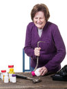 A older woman struggling to open a medicine bottle Royalty Free Stock Images