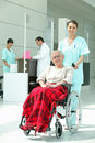 Older woman in a wheelchair nurse pushing an women Stock Photo