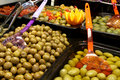 Olive bar containers with different kinds of olives Royalty Free Stock Image