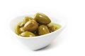 Olive dish isolated with oil on white background Royalty Free Stock Photography