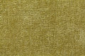 Olive green background from soft textile material. Fabric with natural texture. Royalty Free Stock Photo