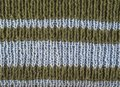 Olive green wool hand knitted texture with light blue stripes ab Royalty Free Stock Photo