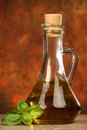 Olive oil and basil bottle with leaves Royalty Free Stock Images