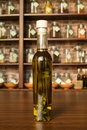 Olive oil bottle with with aromatic herbs Stock Photography