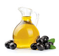Olive oil branch with olives and a bottle of Royalty Free Stock Photo