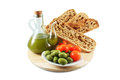 Olive oil bread olives tomatoes healthy foods unfiltered extra virgin whole wheat and Royalty Free Stock Photos