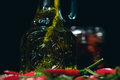 Olive oil and chilli on black Royalty Free Stock Photo