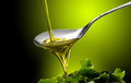 Olive oil close up pure dop poured into spoon Royalty Free Stock Image