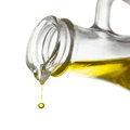 Olive oil drop close up isolated Stock Photos