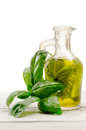 Olive oil flavored with basil leaves Royalty Free Stock Photography