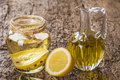 Olive oil flavored with lemon and peppercorns Royalty Free Stock Photo