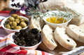 Olive oil green and black olives on the table with chopped fresh ciabatta Stock Photo