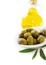 Olive oil and green olives Stock Photos