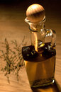 Olive oil with herbs in bottle sunlit Royalty Free Stock Photos