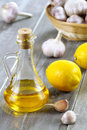 Olive oil, lemon and garlic. Stock Images