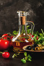 Olive oil, lettuce leaves, tomatoes. Royalty Free Stock Photo