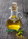Olive oil olive branch wooden table Royalty Free Stock Image