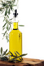 Olive Oil with Olive Tree Branches Royalty Free Stock Photography