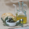 Olive oil with olives and bread Stock Photo